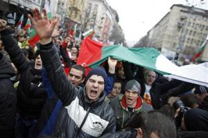 Thousands of demonstrators march shouting slogans during a protest against high utility bills and monopolies in the energy sector in Sofia